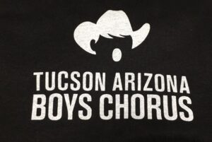 White Tucson Arizona Boys Chorus logo on black background